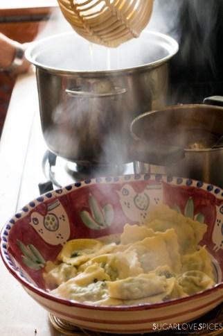 Ricotta and Spinach Ravioli in Tomato Sauce-draining the ravioli