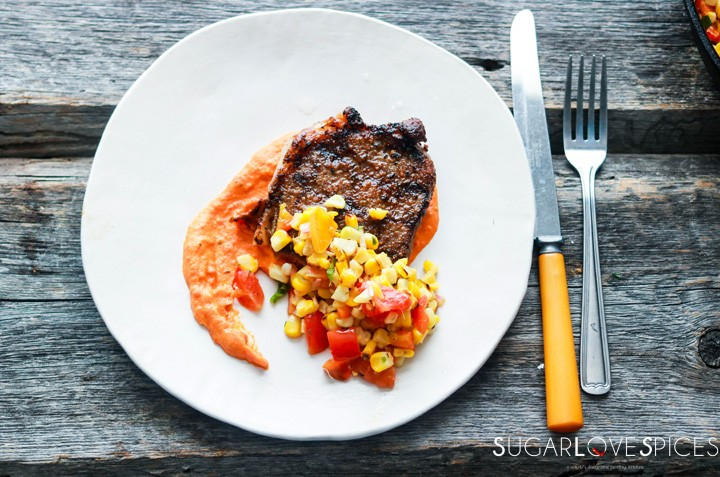 Grilled Ribeye with roasted red pepper and corn succotash-plated with fork
