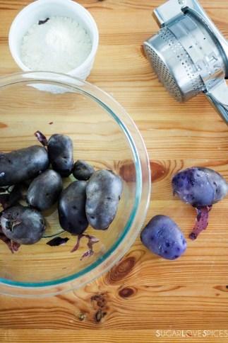 Homemade purple potato gnocchi-peeling-boiled-potatoes-flour-ricer-on-wood-board