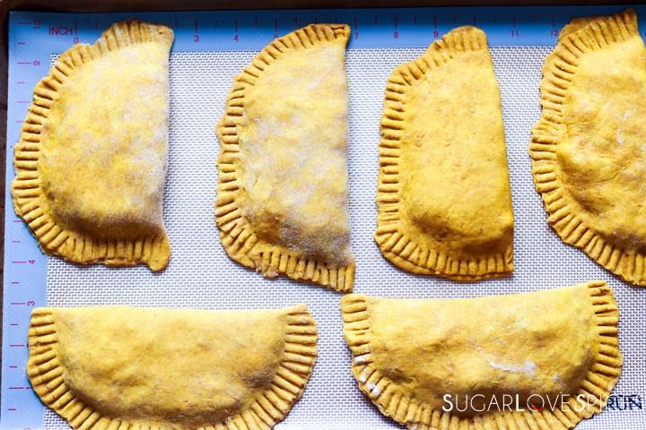 Jamaican Beef Patties-patties in pan unbaked