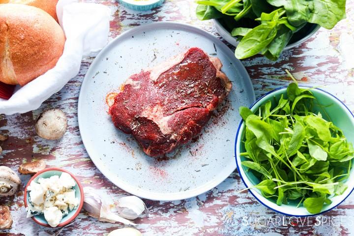 Steak sandwich-ingredients on a wood board