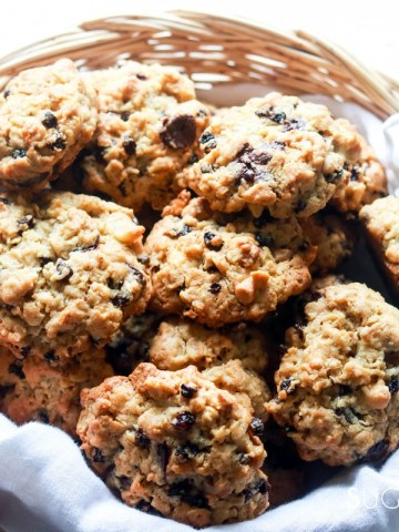 Loaded oatmeal spelt cookies-feature-in a basket-hand