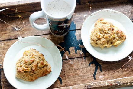 Spiced Apple Eggnog Scones-feature-two scones on a tray with mug and lights