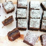 Buckwheat and Jam Cake-feature-squares on a board with spoon and jam