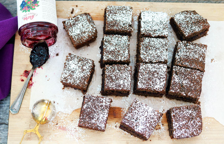 Buckwheat and Jam Cake-squares on a board with spoon and jam