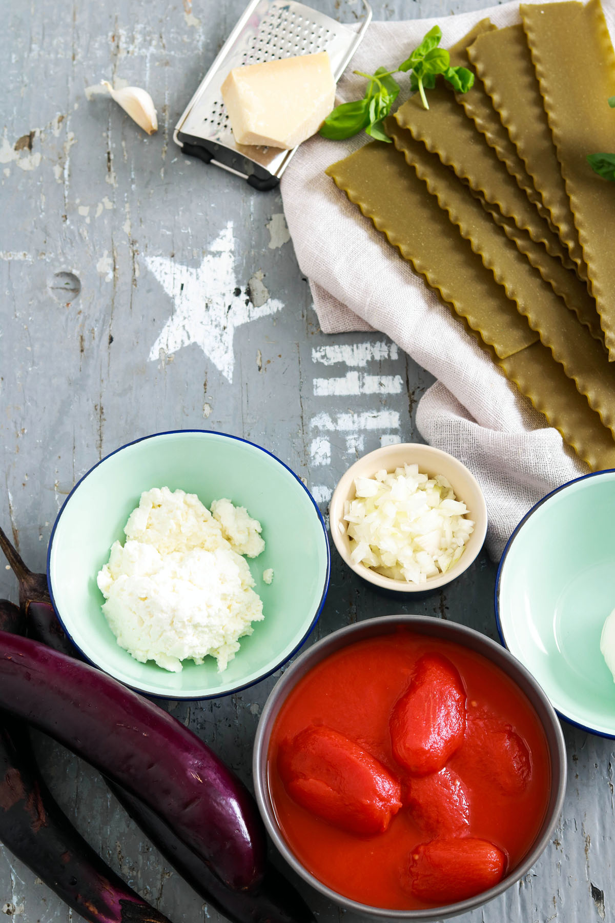 Spinach-Lasagna-Roll-ups-with-Eggplant-mise-en-place-on-grey-wood-board