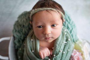 baby girl newborn photography dudley west midlands studio portrait wide eyed mint green