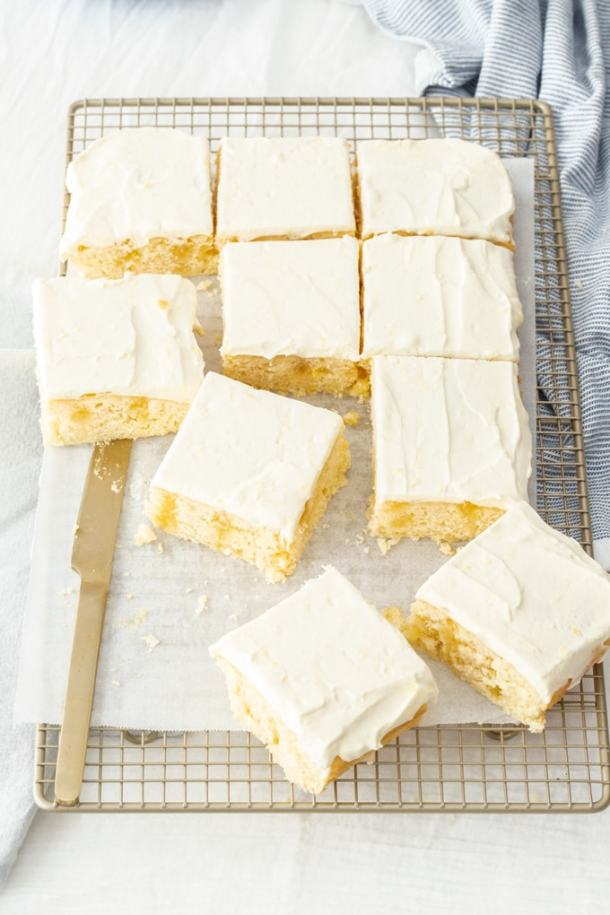 Birdseye view of Lemon Poke Cake slices on a wire cooling rack