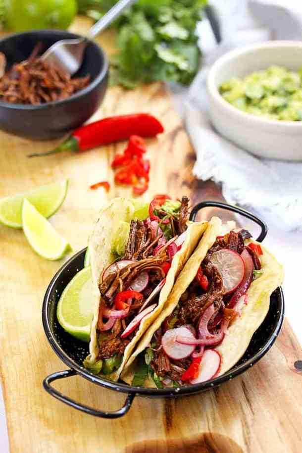 Braised BBQ Beef Short Rib Tacos by Sugar Salt Magic. Succulent, fall-off-the-bone beef short ribs, in a BBQ sauce, enjoyed taco style.