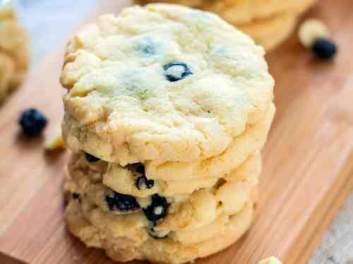 Buttery White Chocolate Blueberry Cookies. The perfect crispy and chewy, buttery cookie filled with dried blueberries and white chocolate & ready in less than half an hour