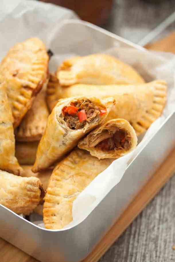 Spicy Pulled Pork Empanadas. Spicy and full of flavour, the pulled pork is encased in a thin flaky pastry