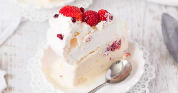 Perfect homemade Pavlova perched atop a creamy, homemade Raspberry Ice Cream base make this Raspberry Pavlova Ice Cream Cake a very special dessert. #pavlovaicecream #australiadayfood