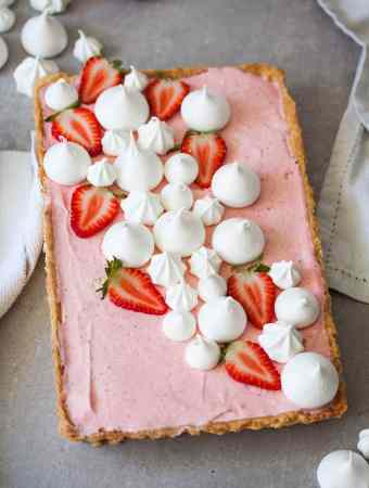 This Strawberry Mousse Tart is a soft silky real strawberry mousse, inside a crisp tart shell and topped with crispy meringue kisses. Such a beautiful Spring dessert.