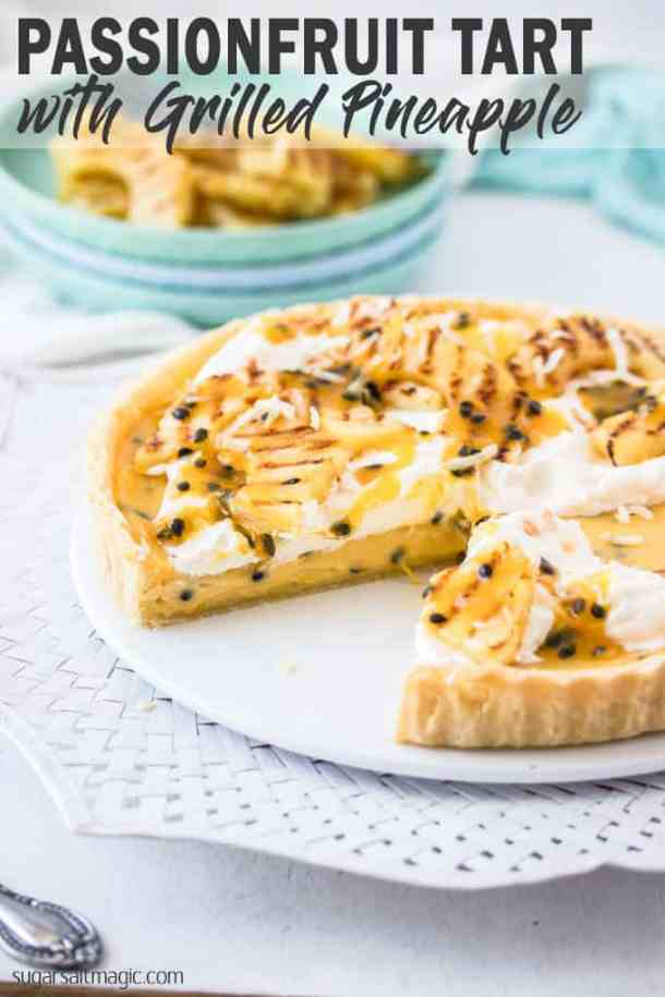 This Passionfruit Tart is a simple passionfruit curd custard filling in a crisp tart shell. It's all topped with grilled pineapple slices and coconut. Tropical dessert heaven. #sugarsaltmagic #passionfruittart #summerfood #summerdesserts #passionfruitdesserts #passionfruitrecipes
