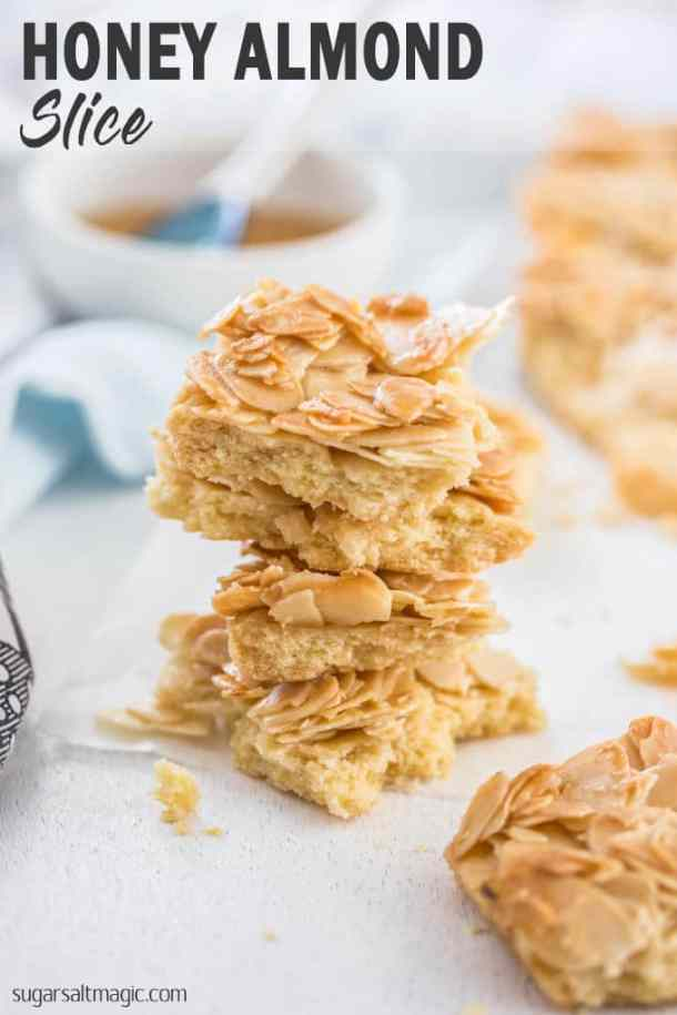 This Honey Almond Slice is an easy shortbread base topped with flaked almonds that have been mixed with a honey butter mixture. It bakes up crispy and chewy and will leave you wanting more. #sugarsaltmagic #honeyalmond #honeyalmondslice #shortbreadslice #almondshortbread #shortbreadrecipe #recipe #shortbread #almond #honeyjoys