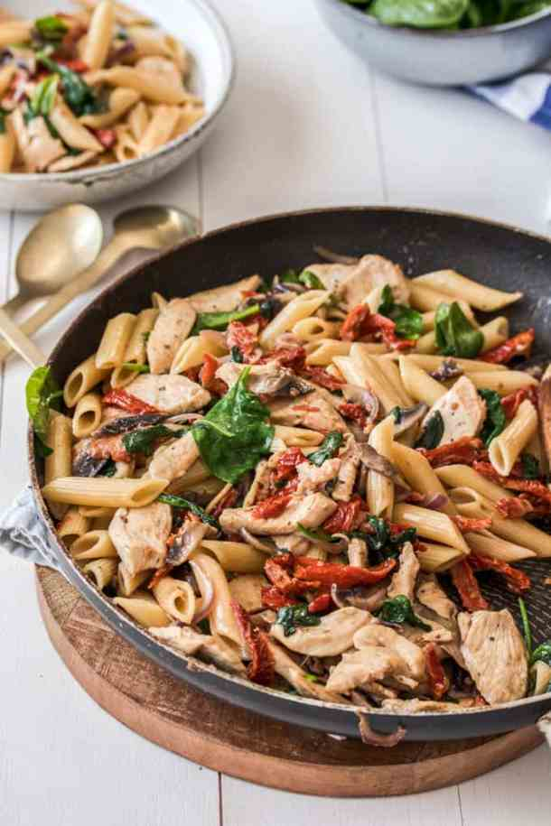 Chicken Penne Pasta with sundried tomatoes in a skillet