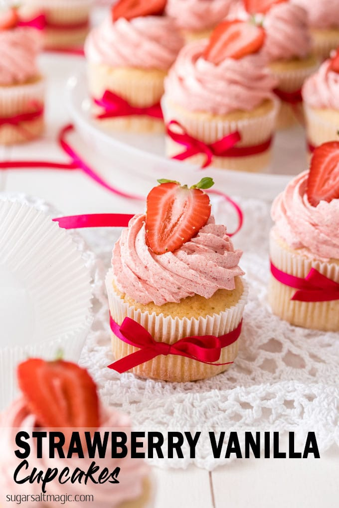 These easy Vanilla Cupcakes take no time at all to mix together. These moist and fluffy cupcakes are topped with a Strawberry Buttercream.