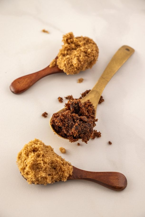 Three spoons with different types of brown sugar