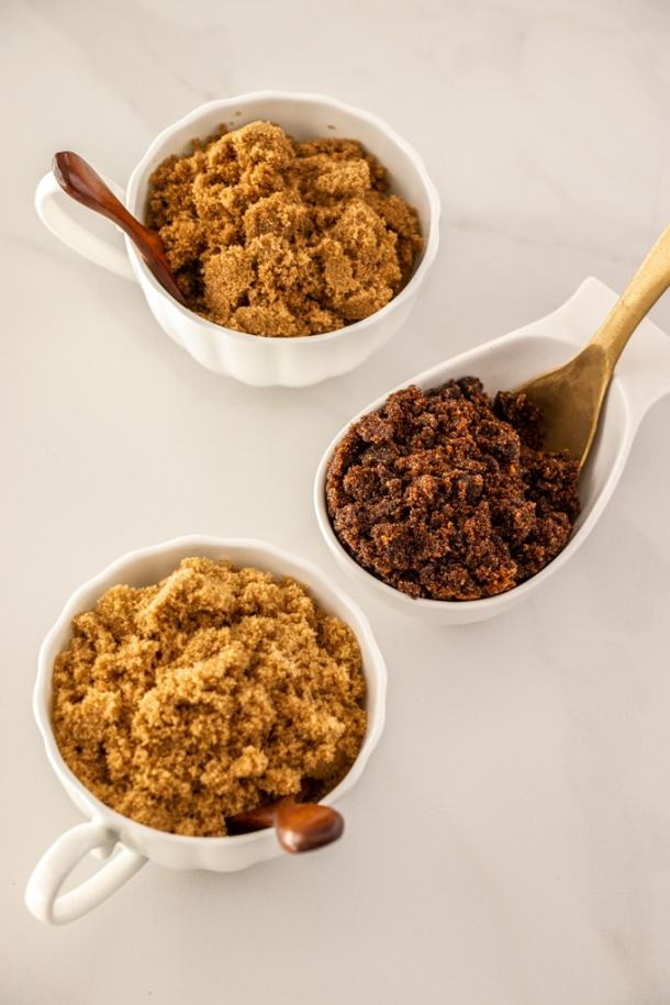 Three bowls with different types of brown sugar