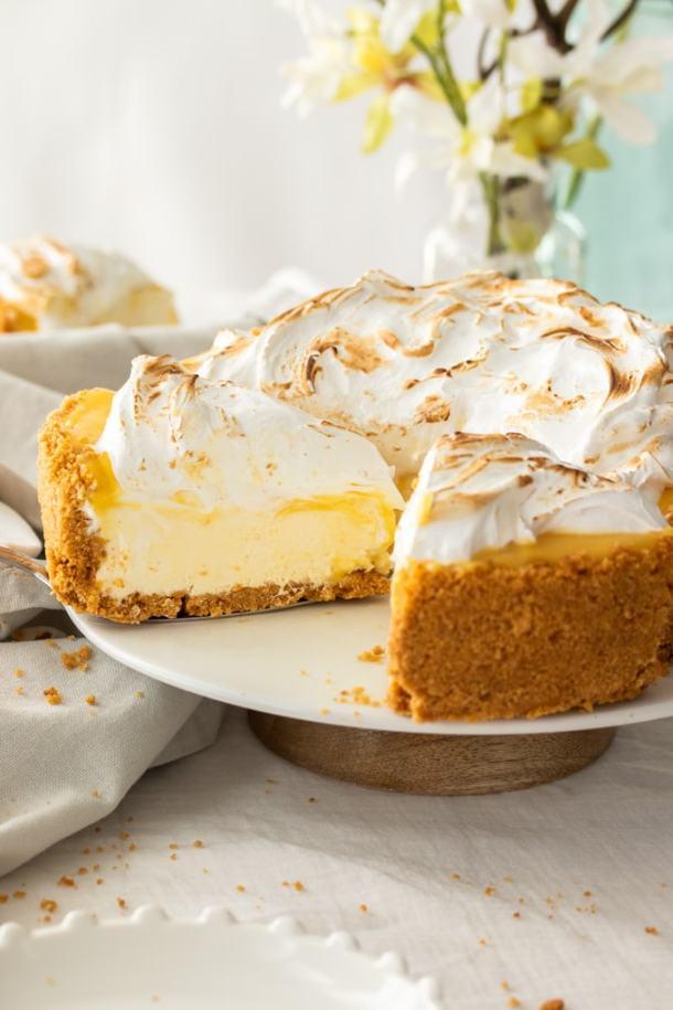 A lemon meringue cheesecake cut open to show the inside