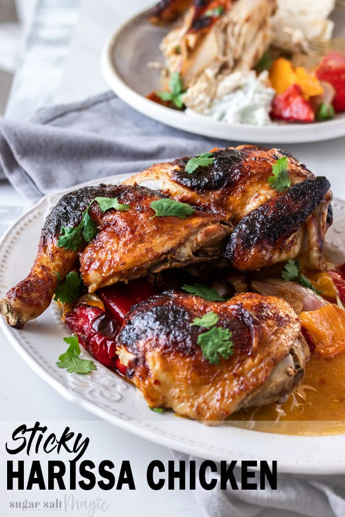 Pieces of roasted chicken on a white oval plate