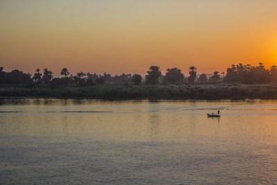 Man in boat Sunset over the Nile Egypt Travel Talk Tours Solo Femele Travel