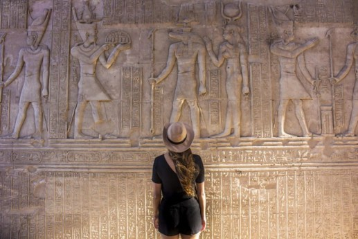 Temple of Kom Ombo reading Hyroglifics - Travel Talk Tours Solo female travel egypt