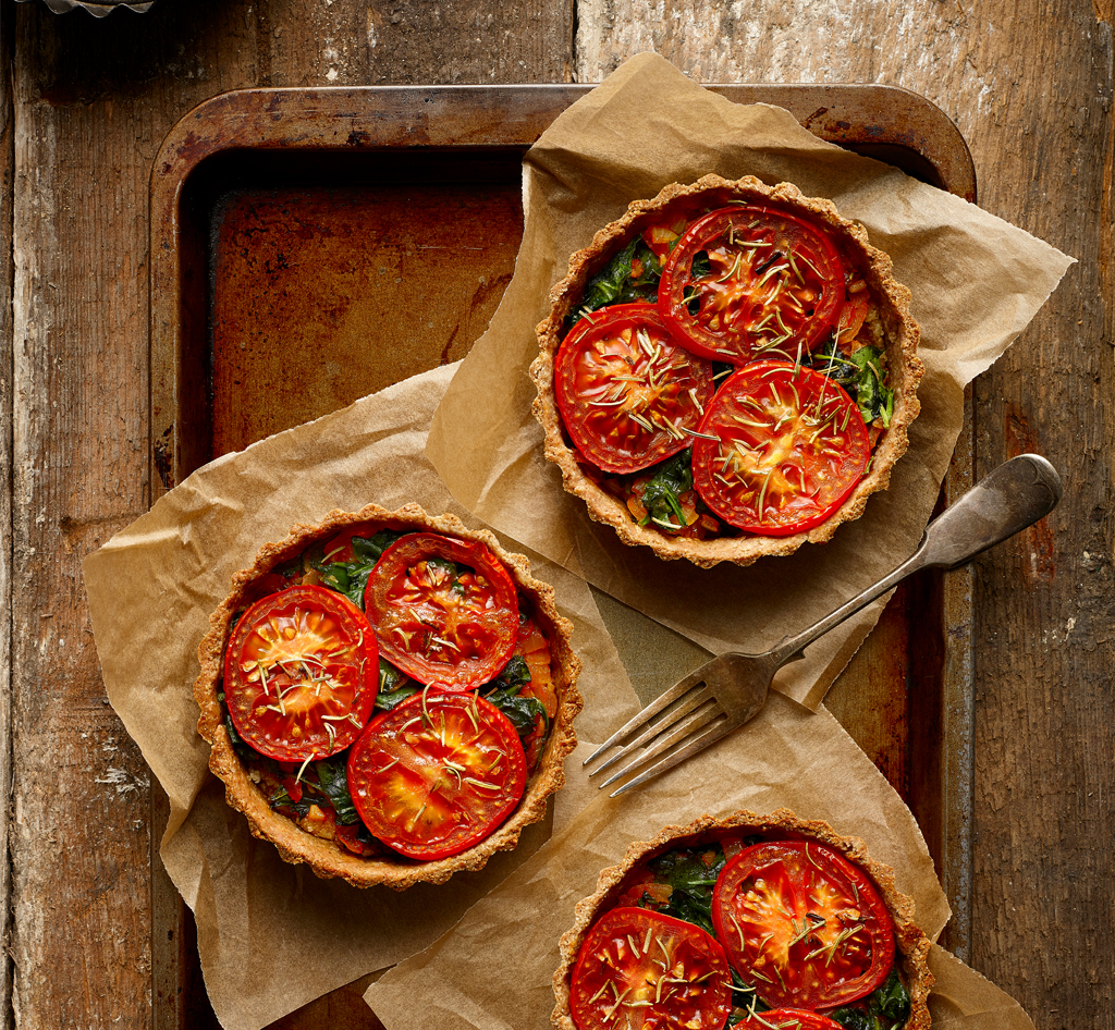 herbed cashew cheese tart with a tomato topping