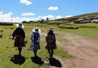 Three local women lead us through the village of Chunu Chununi in Bolivia
