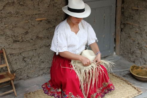 Local woman making straw hats in Sigsig, Ecuador