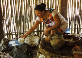 One of our host preparing delightful corn tortillas in a traditional mayan house, in the Mexico tour