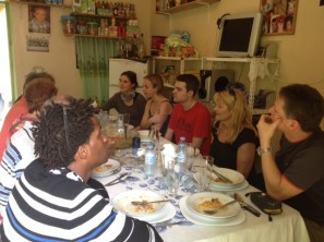 Eating at a house in the community with our guests in Brazil