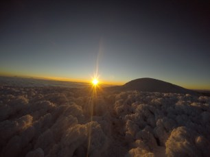 The sun is rising, view from the Chimborazo summit in Ecuador