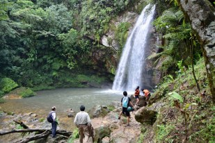 Doing rappel in the Cuetzalan waterfalls in Mexico