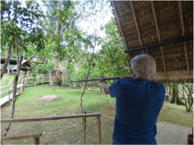 Geoff taking aim with the blowpipe, a tradition of the Mandari Panga community in Ecuador