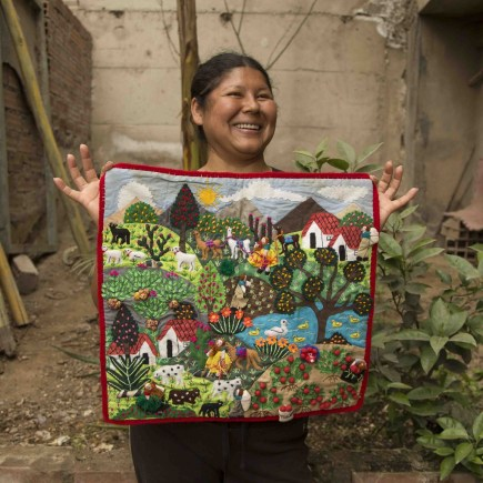 Margarita holds a family patchwork that pictures life in her natal Ayacucho, a very different reality to the one in Lima