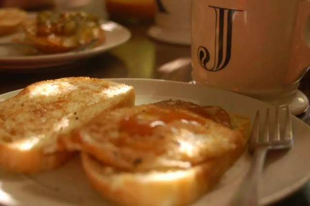 Overeasy Egg on Toast with fresh ground Coffee Exchange coffee.