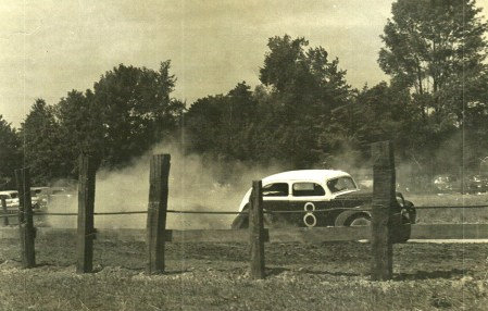 A race car speeds around the dirt track of the Chestnut Grove Raceway. Cora Arkelin collection.