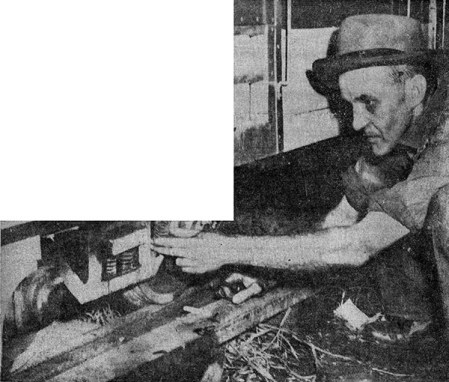 Roy L. McCormack inspects the undercarriage of a passenger car on his railroad. Image from the Ashtabula Star-Beacon, July 11, 1953.