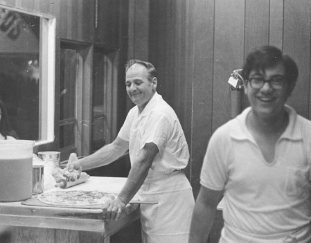 Frank Capo (left) and his son Tony, now the owner, at work in their Geneva-on-the-Lake pizza shop.