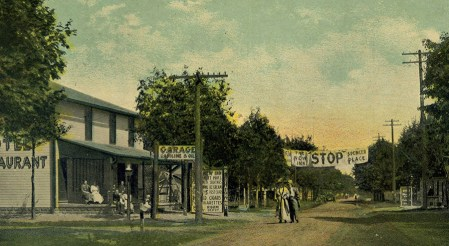 A lady escorted by a gentleman could still walk down the new Lake Road in front of the New Inn and not have to worry about being run over by a car when this postcard was printed, 1915-1920. But notice that The New Inn was already offering garage services.