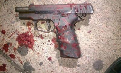 Gun With Blood