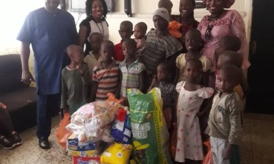 Members of the NGO presenting the items to the Inmates of Uyiosa Ophanage, Benin City