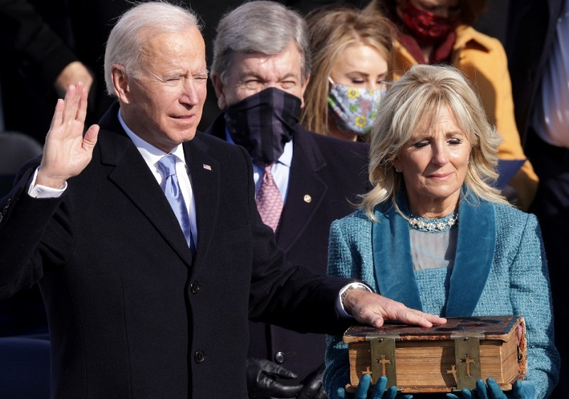 U.S 46th President, Joe Biden (left) taking the Oath of Office at his Inauguration on January 20, 2021
