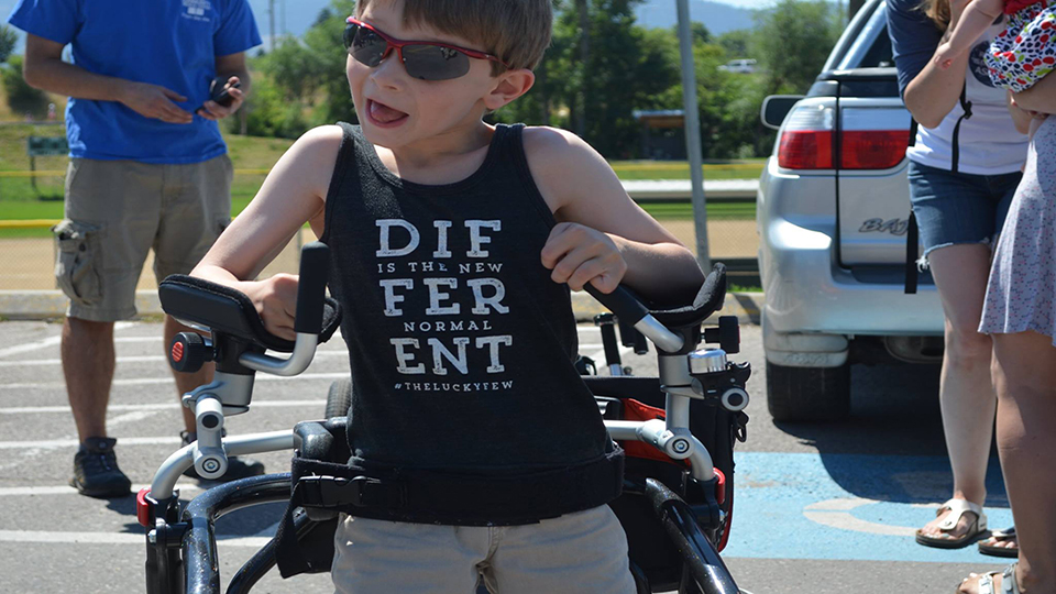 "Child with T-shirt that says ""Different Is the New Normal"""