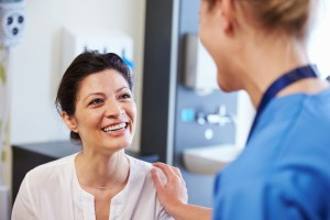 nurse talking with patient in a hospital room