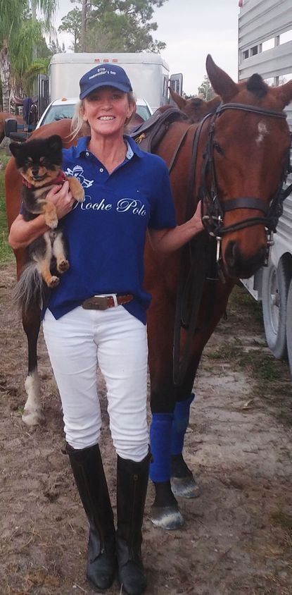 Lauderdale-By-The-Sea resident Helen Roche holds her No. 1 polo fan Teddy next to her horse 213 at the International Polo Club in Wellington.