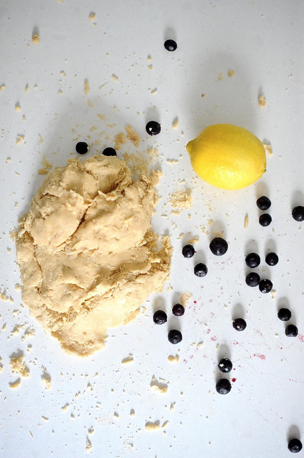 Vegan heart shaped blueberry pop-tarts, dough and lemon.