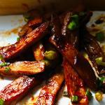 Pile of mushroom ribs on white plate