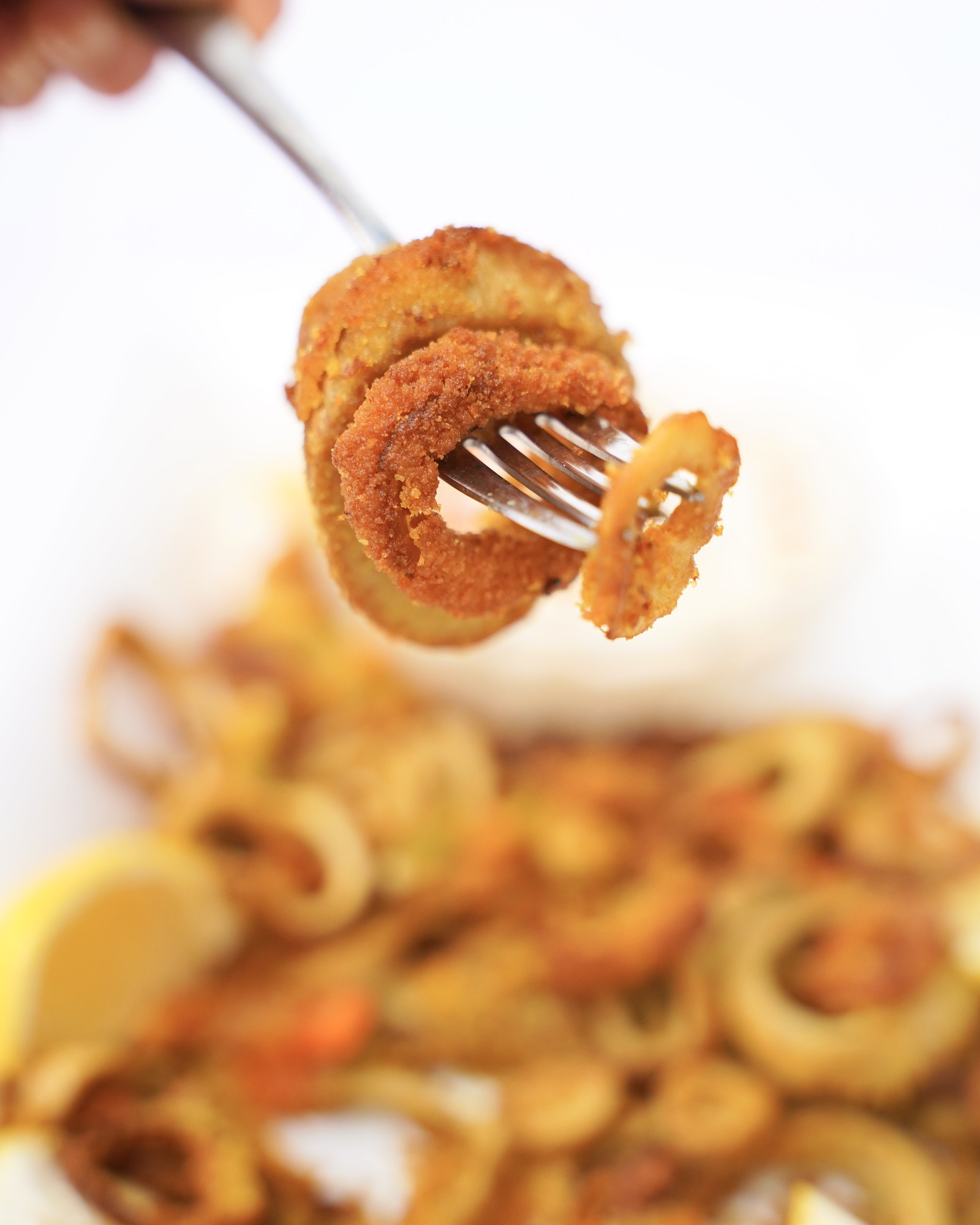 plant based fried vegan calamari on fork
